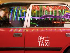 China, Hong Kong, Wan Chai, Nightlife Neon Reflected in a Hong Kong Taxi Window by Gavin Hellier