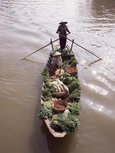 Floating Market Trader and Boat Laden with Vegetables, Phung Hiep, Mekong River Delta, Vietnam by Gavin Hellier