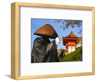 Japan, Honshu, Kansai Region, Kiyomizu-Dera, Shinto Priest Seeking Donations Wearing a Bamboo Hat