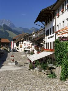 Main Street and 17th Century Houses, Gruyeres, Fribourg Canton, Switzerland by Gavin Hellier
