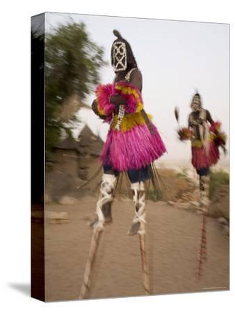 Masked Ceremonial Dogon Dancers on Stilts Near Sangha, Mali, West Africa