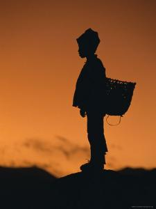 Silhouette of Local Boy at Sunset, Everest Base Camp Trek, Nepal, Asia by Gavin Hellier