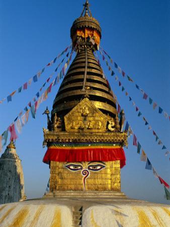 Spire and Prayer Flags of the Swayambhunath Stupa in Kathmandu, Nepal, Asia