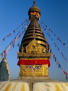 Spire and Prayer Flags of the Swayambhunath Stupa in Kathmandu, Nepal, Asia by Gavin Hellier