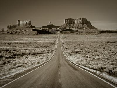 Straight Road Cutting Through Landscape of Monument Valley, Utah, USA