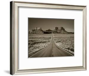 Straight Road Cutting Through Landscape of Monument Valley, Utah, USA by Gavin Hellier