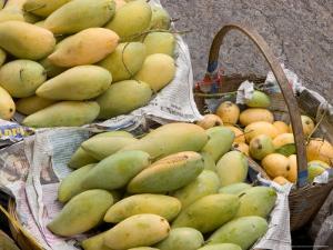 Mangos at Fruit and Vegetable Market, Khon Kaen, Thailand by Gavriel Jecan