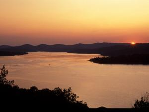Sunset over Table Rock Lake near Kimberling City, Missouri, USA by Gayle Harper