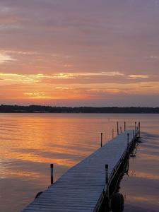 Swimming dock, Cass Lake, Minnesota at sunset by Gayle Harper
