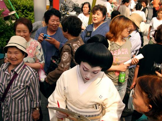 Geisha in Kimono Signing Autograph for Fan, Tokyo, Japan-Greg Elms-Photographic Print