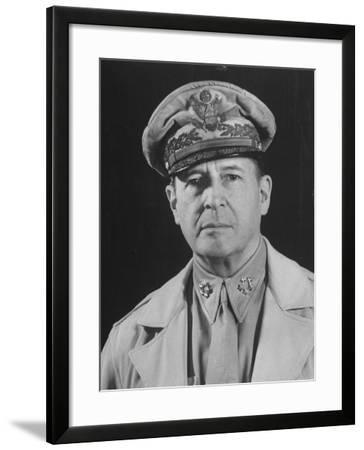 Gen. Douglas Macarthur Posing in a Serious Manner for His Portrait--Framed Photographic Print