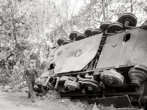 General Dwight D. Eisenhower Passing a Tiger II Tank Turned over on the Road