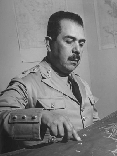 General Lazaro Cardenas, Pointing to a Map as His Continues to Work on a Stradegy-Peter Stackpole-Photographic Print