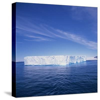 Tabular Iceberg in Blue Sea in Antarctica, Polar Regions