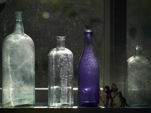 Still Life With Bottles And Found Figurines by Geoffrey Ansel Agrons
