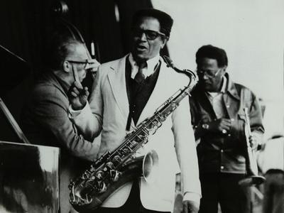 https://imgc.artprintimages.com/img/print/george-duvivier-illinois-jacquet-and-clark-terry-at-the-newport-jazz-festival-middlesbrough-1978_u-l-q10m4ma0.jpg?p=0