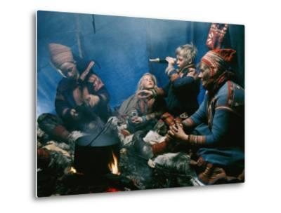 A Lapp Family Prepares a Meal in their Tent