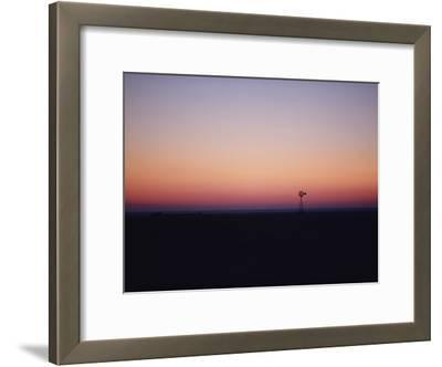 A Solitary Windmill Breaks the Flat Horizon of Dawn