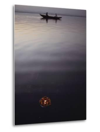 Boaters and a Votive Candle and Marigolds Floating on the Ganges River