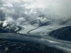 Branches of a Glacier Join Together Below Cloud-Covered Peaks by George F. Mobley