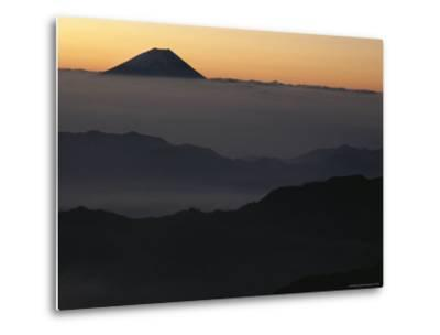Distant View of Mount Fuji Silhouetted against an Orange Sky