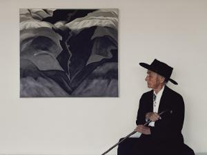 Painter Georgia O'Keeffe Sits before Her Vision of 'Black Place Iii' by George F. Mobley