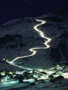 Skiers Bearing Torches Ski Down Mont Blanc Glaciers to Val Disere by George F^ Mobley