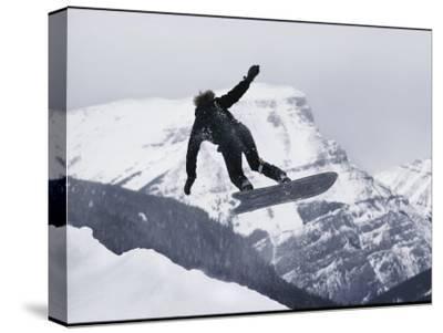 Snowboarder Catches Air, Banff National Park, Alberta, Canada