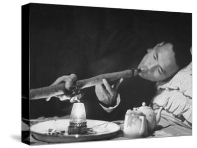 Customer Smoking Opium in an Opium Den