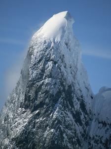 Snowy Peak on Antarctic Coast by George Lepp