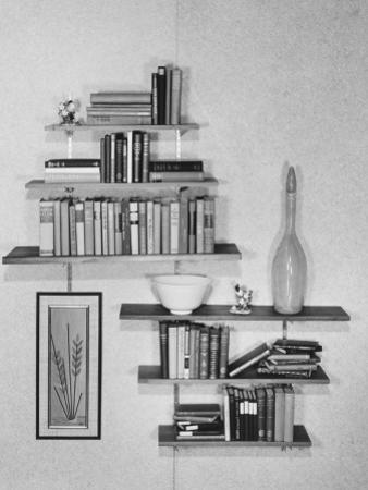 Books and Ceramics on Hanging Wall Shelves