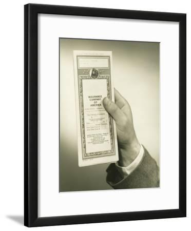Businessman Holding Insurance Policy, Close-Up of Hand