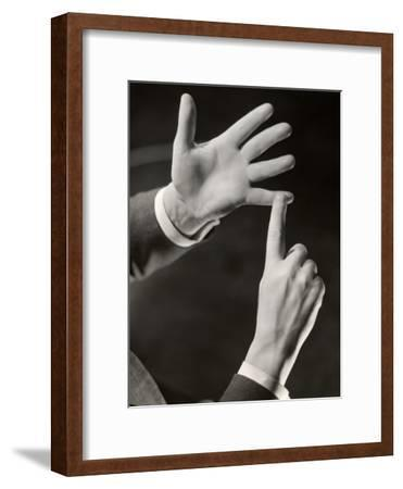 Businessman Making Point With Hands