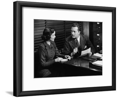 Businessman Talking To Secretary at Desk