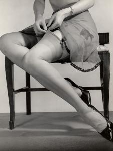 Close-Up of Legs With Garters Being Attached by George Marks