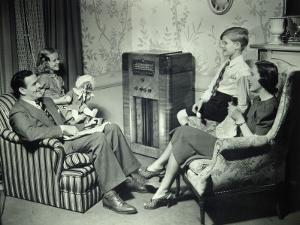 Family Listening To Radio by George Marks