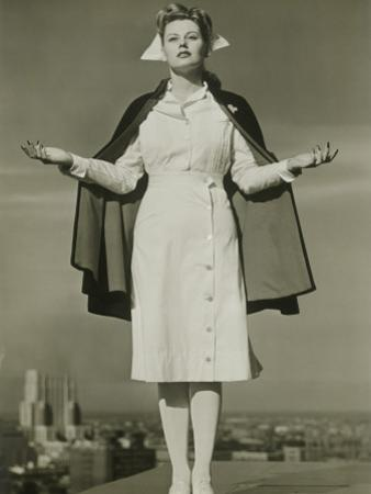 Female Nurse Standing on Rooftop