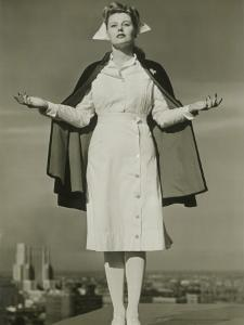 Female Nurse Standing on Rooftop by George Marks