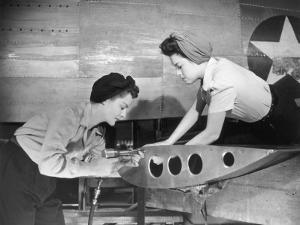 Female Workers Working on Plane by George Marks
