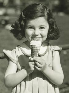 Girl Holding Ice Cream, Posing Outdoors by George Marks