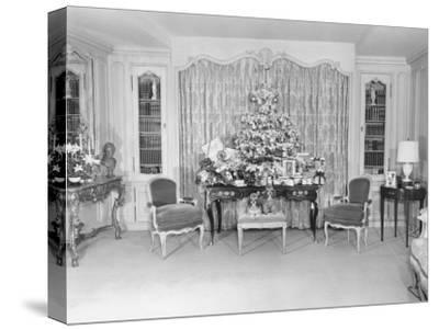 Heavily Decorated Christmas Tree Standing on Period Table
