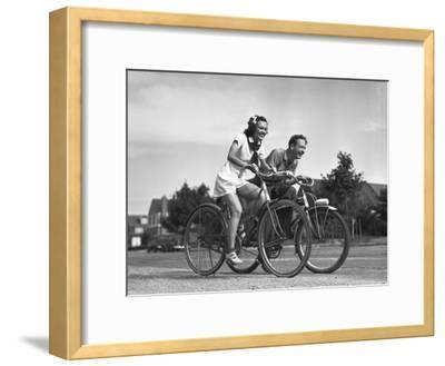 Man and Woman Riding Bicycles, (B&W),