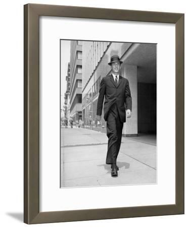 Man in Business Suit Strolling Outdoors