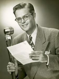 Man Standing Behind Microphone by George Marks