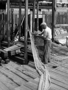 Man Working on Fishing Net by George Marks