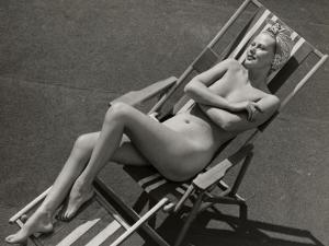 Nude Woman Sunbathing in Beach Chair by George Marks