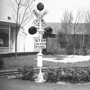 Railroad Crossing Stop Sign and Warning Light by George Marks