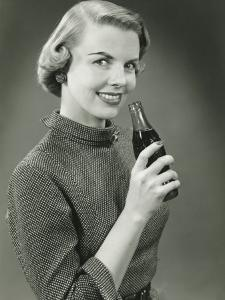 Smiling Woman With Bottle of Coca-Cola Posing in Studio, Portrait by George Marks