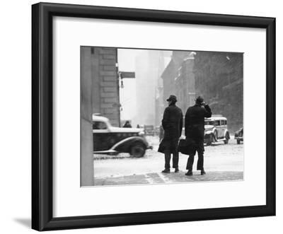 Two Men Walking on City Street in Snow-Storm