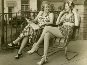 Two Women Lounging Outdoors by George Marks